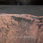 Deluxe Purpurina Collection sobre microcemento color negro